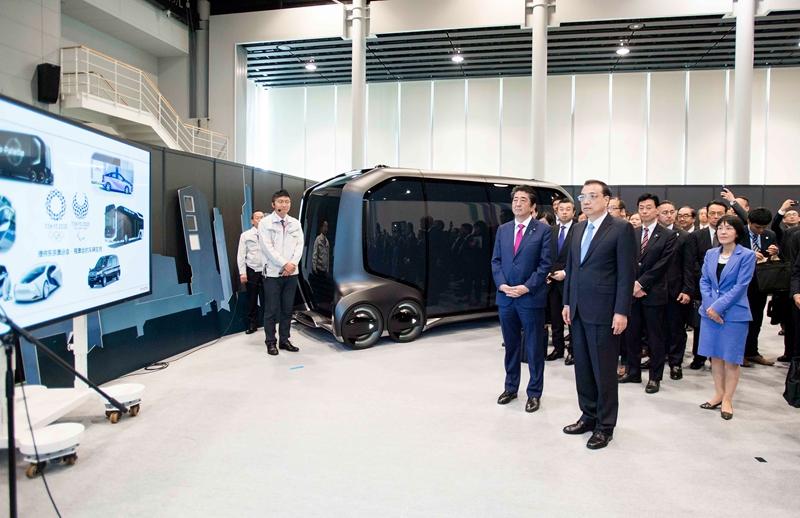 1526257894216754.jpg李克强总理参观丰田汽车厂区释放什么信号?